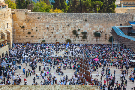 sukkoth festival: The huge crowd of Jews for a prayer has gathered on the square. Autumn holiday of Sukkot in Jerusalem. Western Wall of the Temple