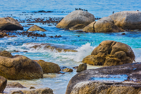 ecotourism: The concept of ecotourism. Huge boulders on the beach of the Atlantic Ocean. Boulders Penguin Colony in the Table Mountain National Park, South Africa Stock Photo