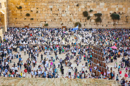 sukkoth festival: Autumn holiday of Sukkot in Jerusalem. Western Wall of the Temple. The huge crowd of Jews for a prayer has gathered on the square