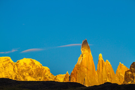 Fiery sunset illuminates the majestic mountains - rock Fitz Roy. Thd stunning Patagonia Stock Photo