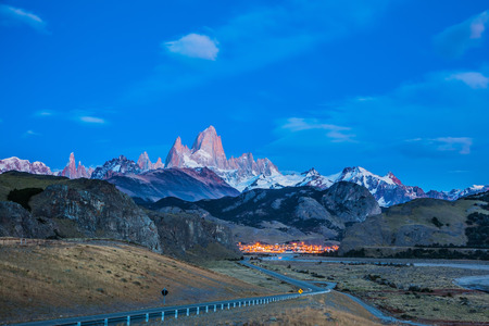 roy: Amazing Patagonia in February. The valley of town of El Chalten.  The white top of Fitzroy rocks and village of El Chalten at dusk