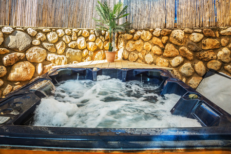 Bathtub -  jacuzzi in garden. Water in bathtub rages
