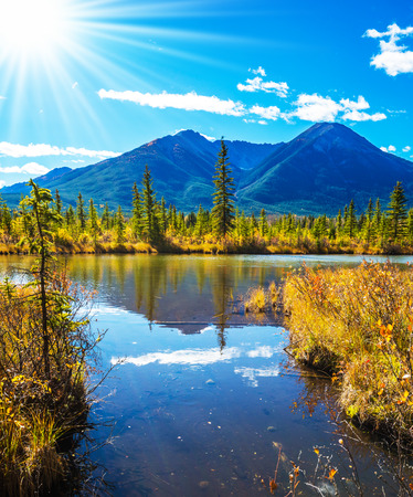 ecotourism: Concept of ecotourism. Rocky Mountains, Canada. Gorgeous sunset on the Vermilion Lakes in mountains of Banff National Park