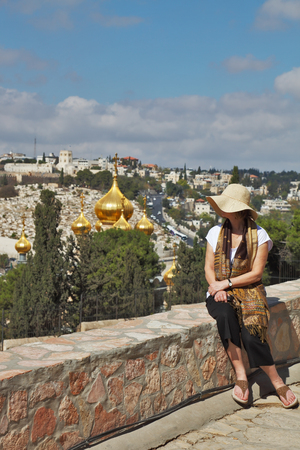 holyland: The magnificent golden domes of the Orthodox Church in Jerusalem. Admiring a woman looks at the panorama of Jerusalem in the hills