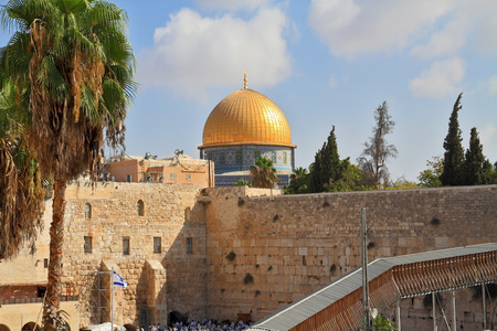 omar: The Western Wall of the Temple and the Mosque of Omar.  The golden dome shines in the morning sun Editorial