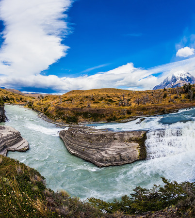 Chile, Paine Cascades. National Park Torres del Paine National Park - Biosphere Reserve. Cold water is emerald Paine river forms a cascading waterfalls Stock Photo