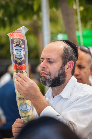 JERUSALEM, ISRAEL - OCTOBER 8, 2014: Sukkot in Israel. Traditional pre-market in Jerusalem. Religious Jews are buying products for the holiday