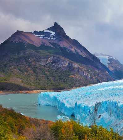 argentino: Colossal Perito Moreno glacier in Lake Argentino, surrounded by mountains. Los Glaciares National Park. Sunny summer day
