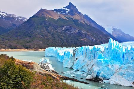 argentino: Los Glaciares National Park in Argentina. Sunny summer day.  Colossal Perito Moreno glacier in Lake Argentino