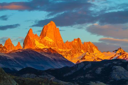 crimson colour: Blood-red sunset illuminates the top of impressive cliffs Fitz Roy. Fantastic Patagonia
