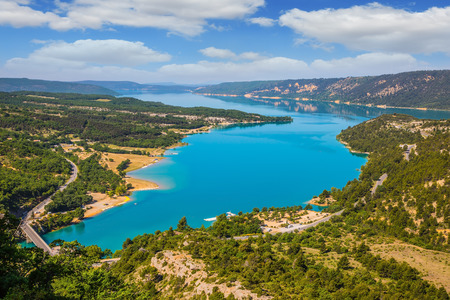 Magnificent lake with turquoise water among wooded hills. Canyon of Verdon, Provence, May