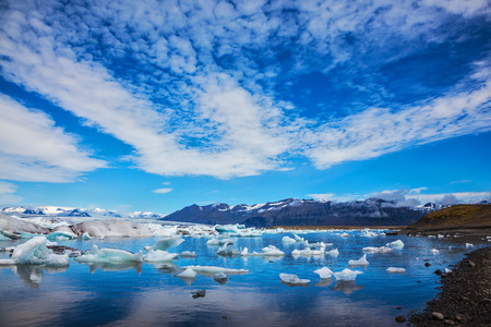 Beautiful summer morning in the ocean bay with ice floes. Ice lagoon in Iceland Stock Photo