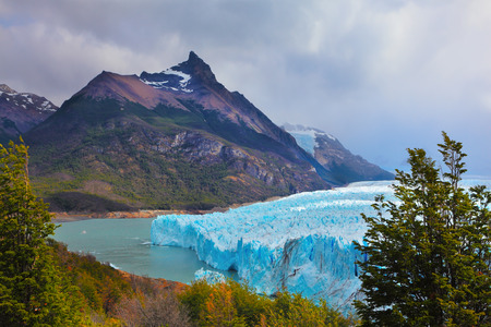 argentino: Los Glaciares National Park in Patagonia. Huge Perito Moreno glacier in the Lake Argentino, surrounded by mountains. Sunny summer day