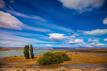 scorched: Argentine Patagonia in February. Yellow flat scorched desert with shallow lakes
