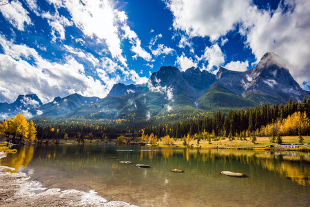 canmore: The famous Three Sisters mountains in the Canadian Rockies  of Canada. Auroral sunny day in Canmore. Concept of hiking