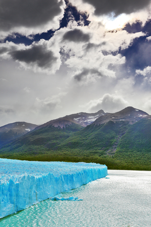 argentino: Colossal Perito Moreno glacier in Lake Argentino. Los Glaciares National Park in Argentina. Sunny and windy summer day