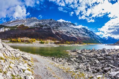 Stony shore of Medicine Lake in the fall shoaled. Jasper National Park, Canada Stock Photo