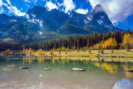 canmore: Shining day in Canmore. The famous Three Sisters mountains in the Canadian Rockies. Concept of hiking