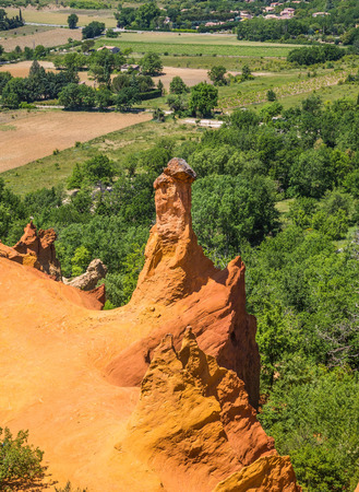 The reserve - pit on production ochre. Languedoc - Roussillon, Provence, France. Orange and red picturesque hills