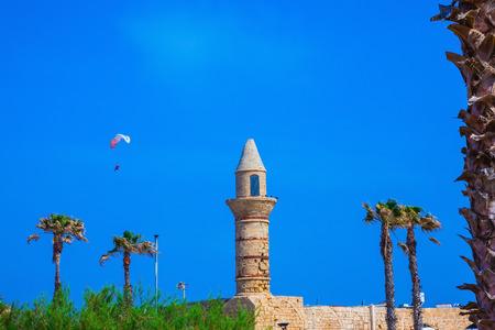 Palm tree, minaret and parachute.  National park Caesarea on the Mediterranean Sea Stock Photo