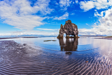 Stone mammoth Iceland. The picturesque cliff in Bay of Hoonah. Hvitserkur rocks during low tide at sunset Stock Photo