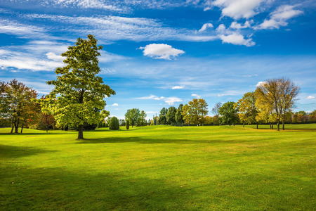 Concept of recreational tourism. Golf Club on the road to Bromont, French Canada. Grassy field in a beautiful park Stock Photo