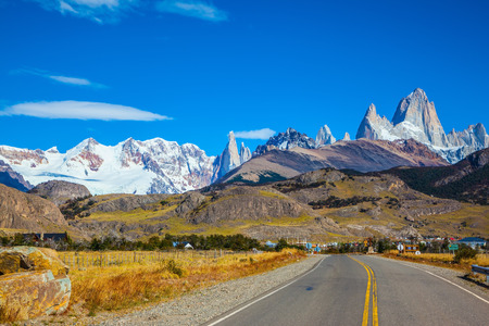 Sunny day in February in Argentine Patagonia. The beautiful concrete highway to the majestic mountain Fiz Roy Stock Photo