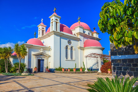 Pink domes and golden crosses crowned with snow-white church building. Greek church of the Cathedral of the twelve apostles Stock Photo