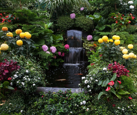 Butchart Garden on Vancouver Island, Canada. Luxury three-stage Fountain Mirror stream among the flowers