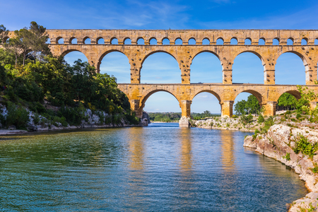 storied: Three-storied aqueduct of Pont du Gard - the highest in Europe. The bridge was built at the time of Roman Empire on river Gardon. Provence, spring sunny day Stock Photo