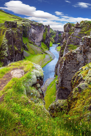 very cold: Fantastic canyon in Iceland - Fyadrarglyufur. Steep vertical cliffs surround the stream of very cold water. The concept of active northern tourism
