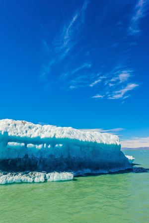 Excursion by boat to the huge white-blue glacier.