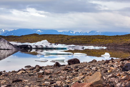 Summer in Iceland.  The lake with ice floes formed by thawed snow of glacier Vatnajokull.  The concept of northern tourism Stock Photo