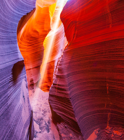 The Navajo reservation in Arizona, USA. Famous midday sun ray in  slot canyon Antelope