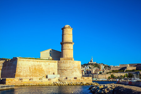 st john: Fort St. John in Marseille. Most watchtower is reflected in the blue water port