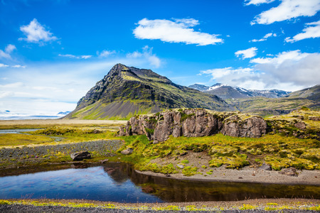Tundra in Iceland. Summer tour in the Nordic countries. The concept of extreme northern tourism