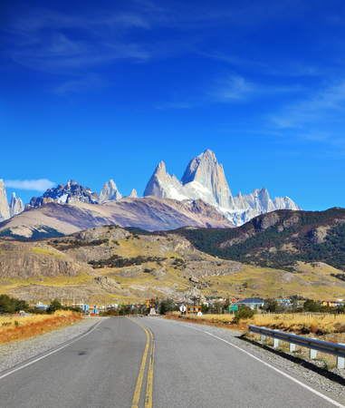 Famous rock Fitz Roy peaks in the Andes. Magnificent panorama of snow-capped mountains in Patagonia. Excellent highway in El Chalten
