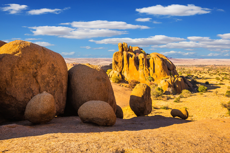 Huge granite rocks and stones in the Desert Namib. Spitzkoppe, Namibia. Play of light and shadow on the rocks. Concept of extreme and ecological tourism Stock Photo