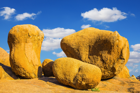 Huge granite stones and rocks on a background of blue sky. Desert Namib, Spitzkoppe, Namibia. Concept of extreme and ecological tourism