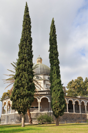 holyland: Israel, lake Tiberias. Basilica on Mount of Beatitudes. The majestic dome and gallery with columns are surrounded by cypresses Stock Photo