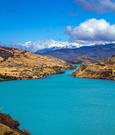 Rio Paine - the emerald water of the river among hills of the park. Torres del Paine National Park. Summer in the south of Chile. The concept of extreme and active tourism Stock Photo