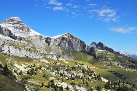 sharp: Swiss Alps in early fall. Cold sharp rocks slightly sprinkled with the first snow