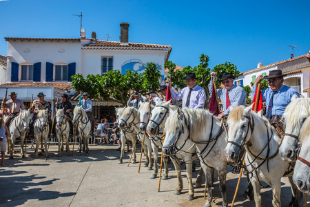 Sent-Mari-de-la-Mer, Provence, France - May 25, 2015. Guards on white horses before the start of the parade. World Festival of Gypsies. The concept of ethnographic tourism