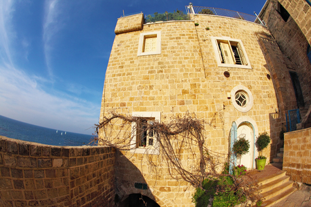 yaffo: The ancient stone house in Old Yaffo. Warm day in December