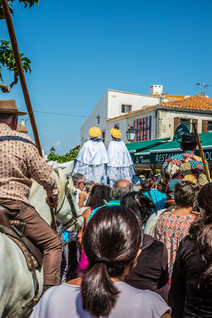 camargue: Saintes-Maries-de-la-Mer, France - May 25, 2015. The concept of ethnographic tourism. A huge crowd accompanies two statues Saintes-Maries. Religious feast of the Holy Maries in Provence Editorial
