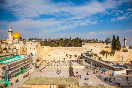 Autumn holiday Sukkot. The greatest shrine of Judaism. The Western Wall of the Temple is preparing for evening prayer Stock Photo