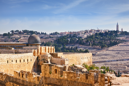 dome of the rock: The walls of Jerusalem. In the distance you can see the gray dome of the Al-Aqsa Mosque and the Muslim minaret