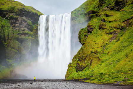 Magnificent famous waterfall Skógafoss, Iceland. A powerful jet Skógar River forms a large rainbow.