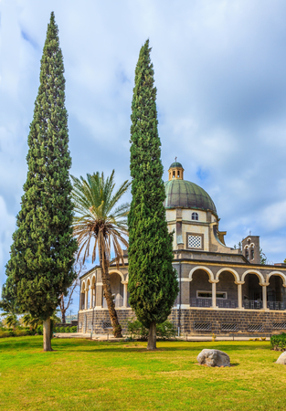 Catholic monastery and a small church Mount of Beatitudes. Beautiful park of cypress and palm trees. Israel, the shores of Lake Kinneret Banco de Imagens