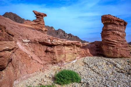 Outcrops of pink sandstone unusual forms. Israel.  Dry mountains of Eilat on a warm day in January